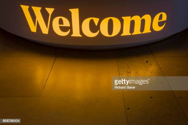 The yellow light from a Welcome sign is reflected on the floor of the Festival Hall on London's Southbank on 5th October in London England