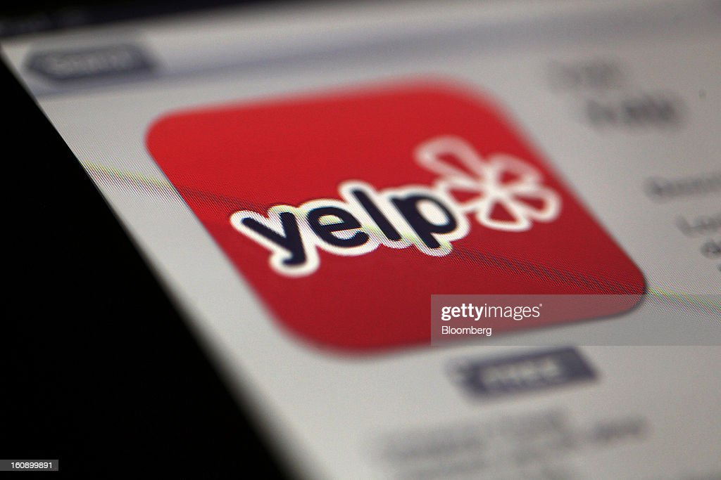 The Yelp Inc. app logo is displayed on an Apple Inc. iPad in Des Plaines, Illinois, U.S., on Tuesday, Feb. 5, 2013. Yelp Inc., owner of a website that lets consumers review local businesses, slipped after posting a wider quarterly loss than analysts estimated as it boosted spending on expansion into new markets. Photographer: Tim Boyle/Bloomberg via Getty Images