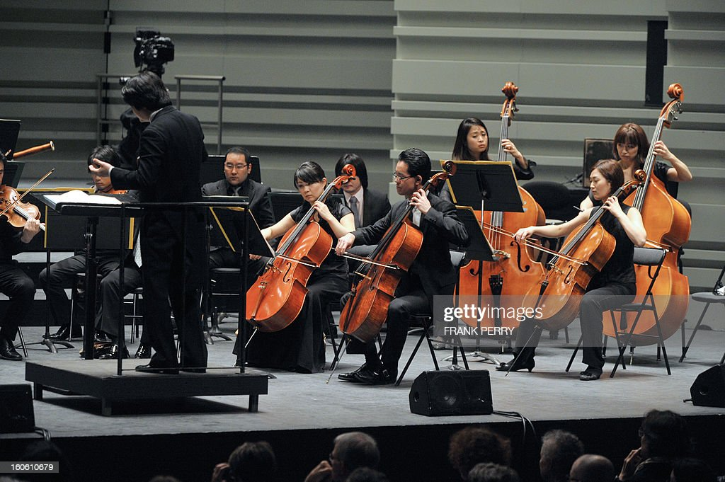 The Yokohama Sinfonietta conducted by Kazuki Yamada perform on February 3, 2013, during the 'Folle Journee' music festival at the Cite des Congres in Nantes.