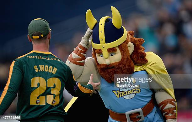 The Yorkshire Viking mascot jokes around with Sam Wood of Nottinghamshire during the NatWest T20 Blast match between Yorkshire and Nottinghamshire at...
