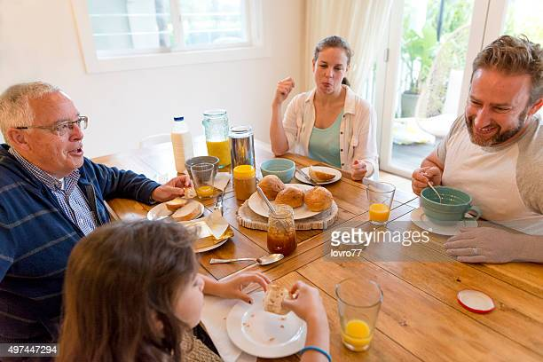 The young Australian family enjoying breakfast