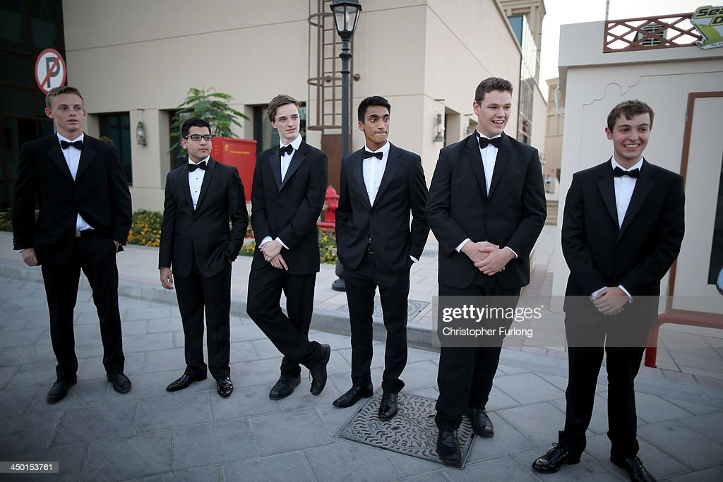 The young escorts wait for the arrival of the debutantes for the The London Season Ball on The World, (L-R) Jack Stapley, 17, Raunak Bhojwani, 18, Matthew Philips, 17, Neil Matthias, 18, Owen Westall, 17 and Thomas Francis also 17 on November 14, 2013 in Dubai, United Arab Emirates. Debutantes, royalty and aristocracy, attended The London Season Ball on the World hosted on the exclusive and privately owned Royal Island off the coast of Dubai. The ball follows the tradition of the historical Queen Charlotte's Ball held annually in London. The ball is the inaugural party of the London Season Academy in Dubai, offering classes in etiquette in social and business protocol.