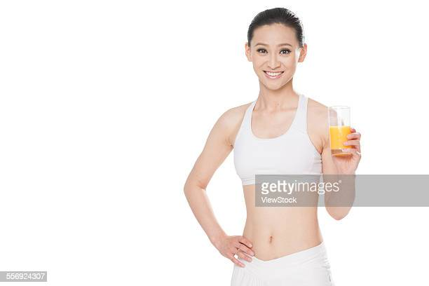 The young girl with fruit juice
