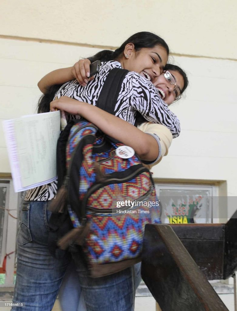 The young girls hug each other after their name appeared in first cut off list for admission in the graduation course at Kamala Nehru College on June 27, 2013 in New Delhi, India.