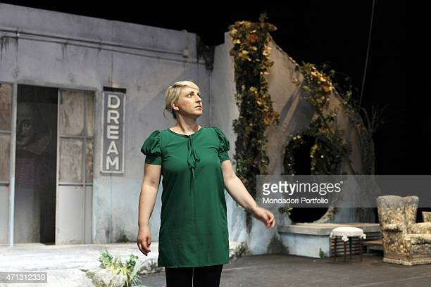 The young Italian actress Katia Follesa standing on the stage plays the part of Hermia the main character of A Midsummer Night's Dream by William...
