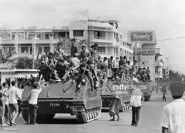 The young Khmer Rouge guerrilla soldiers atop their USmade armored vehicles enter 17 April 1975 Phnom Penh the day Cambodia fell under the control of...