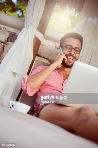 The young man resting at home and technology communication