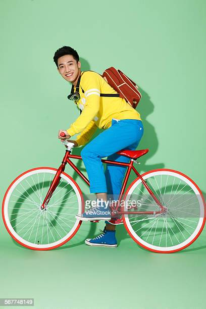 The young man riding a bicycle
