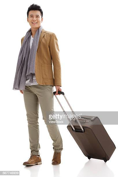 The young man took the suitcase travel