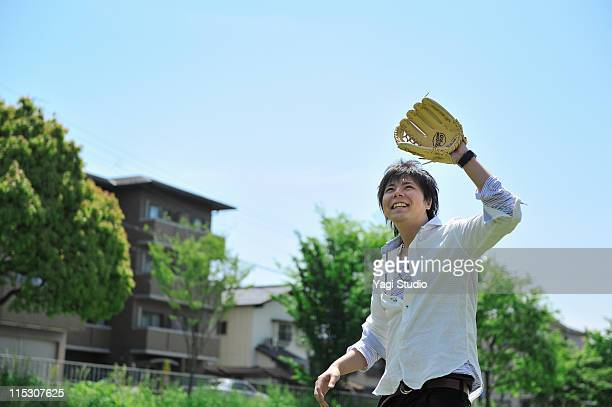 The young man who is playing basebal.