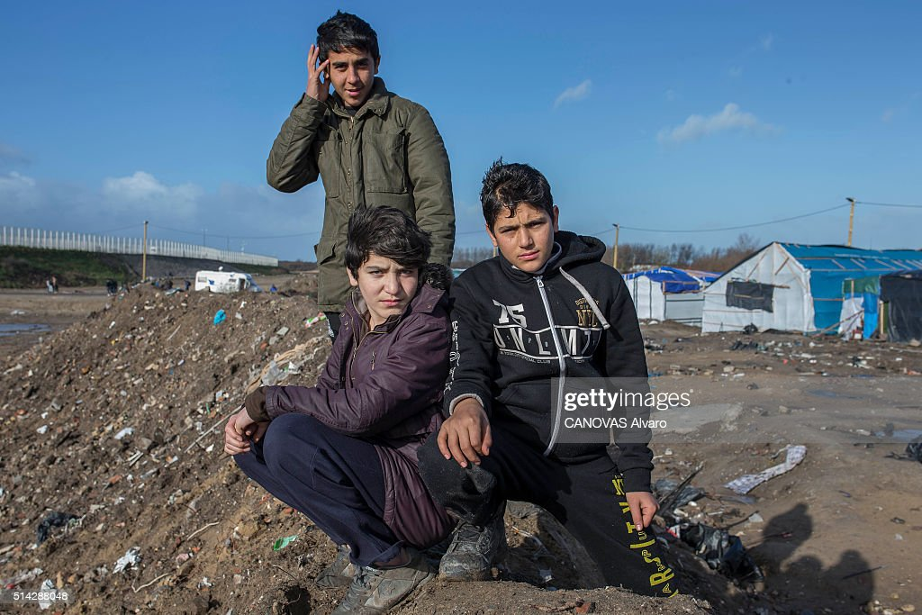 The Young orphans Abdulrach 16 years, Wahid 15 years and Imran 12 years are photographed for Paris Match in the jungle of Calais, France on february 07, 2016.