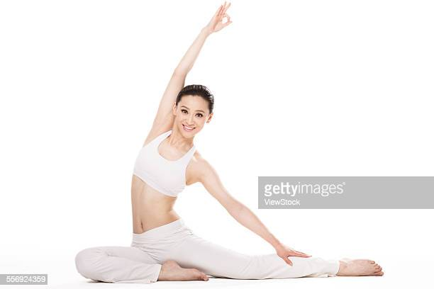 The young woman is doing yoga
