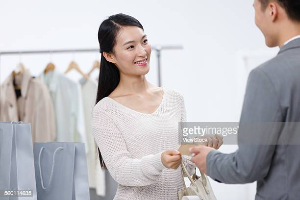 The young woman to buy clothes in the clothing store