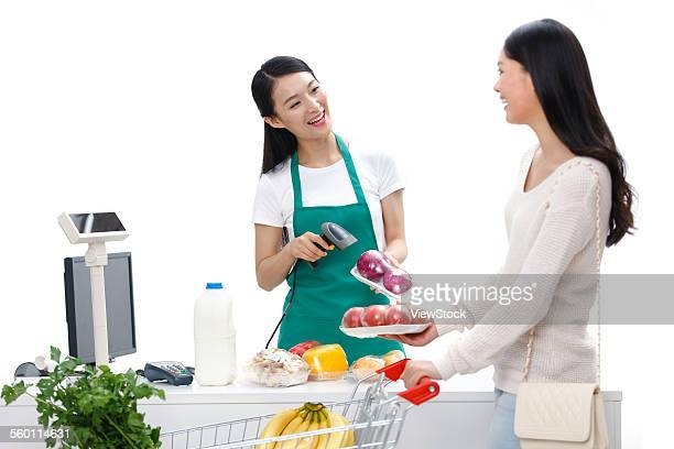 chinese cashier working at grocery store checkout stand stock