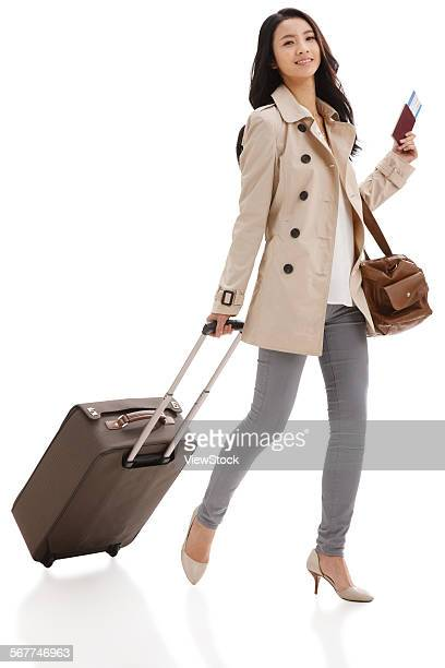 The young woman took the suitcase to travel