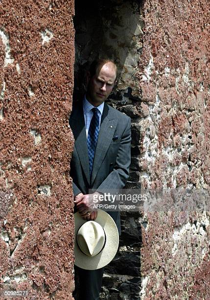 The youngest son of Britain's Queen Elizabeth II Prince Edward stands at the entrance of the Slaves House 04 june 2004 during his visit to Goree...