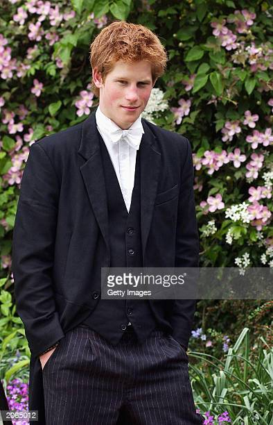 The youngest son of the Prince of Wales Prince Harry poses for photographs on May 12 2003 at Eton College Eton in England Prince Harry will finish...