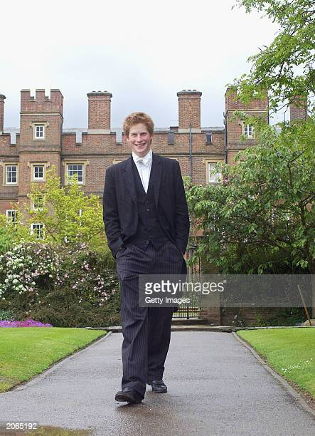 The youngest son of the Prince of Wales Prince Harry wearing his School Dress which consists of a black tailcoat a waistcoat and pinstriped trousers...