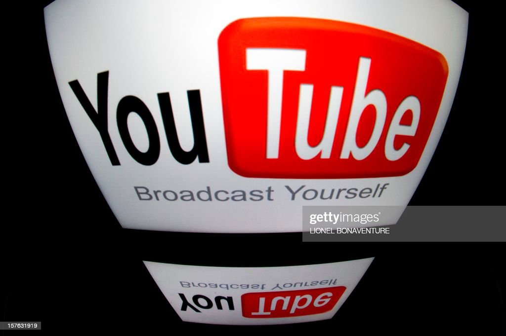 The 'YouTube' logo is seen on a tablet screen on December 4, 2012 in Paris.