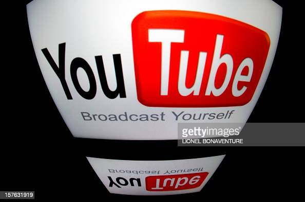 The 'YouTube' logo is seen on a tablet screen on December 4 2012 in Paris AFP PHOTO / LIONEL BONAVENTURE