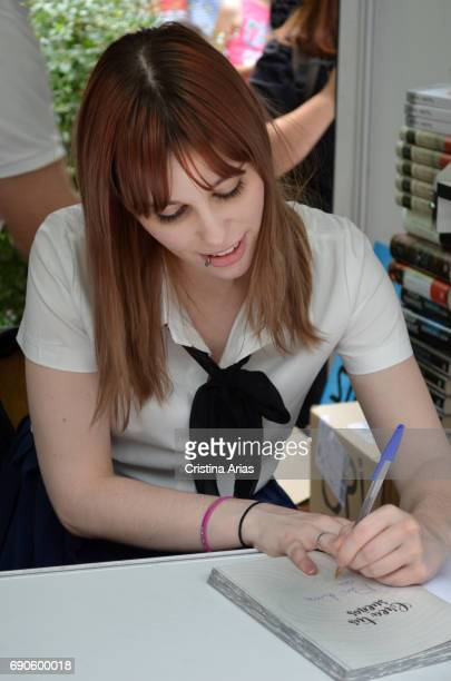 The youtuber and writer Luna Dangelis signsa book during the Book Fair 2017 at El Retiro Park on May 28 2017 in Madrid Spain