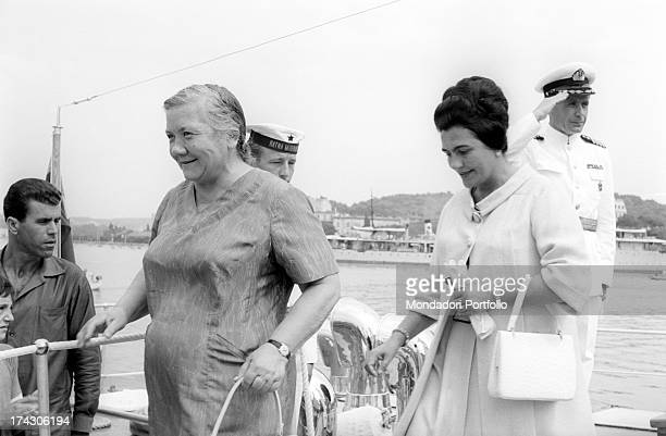The Yugoslavia First Lady Jovanka Broz and Nina Khrushchev the Soviet leader Nikita Khrushchev's wife are getting on board on a boat and are being...