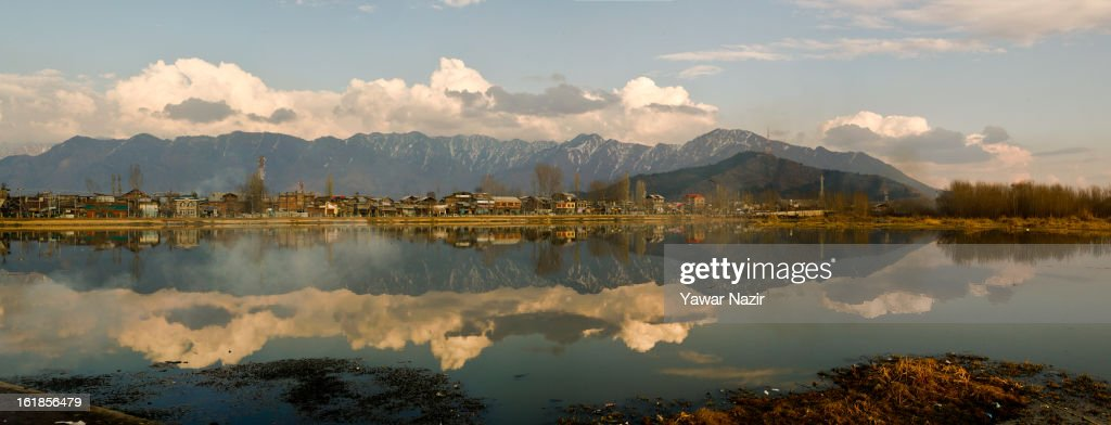 The Zabarvan Mountains are reflected on the waters of Barari Numbal Lagoon during a strike call given by separatists against the execution of alleged Indian parliament attacker Mohammad Afzal Guru on February 17, 2013 in Srinagar, the summer capital of Indian Administered Kashmir, India. Normal life remains affected in Indian-administered Kashmir for the ninth consecutive day as a complete shutdown was observed on the call of separatist leader Syed Ali Shah Geelani. Afzal Guru was hanged on February 9 for his alleged role in the 2001 Indian parliament attack which left 14 dead. Clashes between Kashmiri youth and Indian police were also reported in several parts of the disputed Himalayan region, which was put under a strict curfew for a week by Indian authorities worried about massive public protests following Guru's hanging last Saturday.