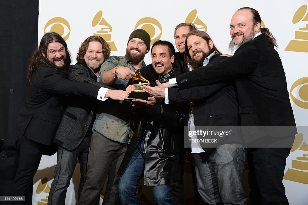 The Zac Brown Band pose with their trophy for best Country album for 'Uncaged' in the press room at the Staples Center during the 55th Grammy Awards in Los Angeles, California, February 10, 2013. AFP PHOTO Robyn BECK
