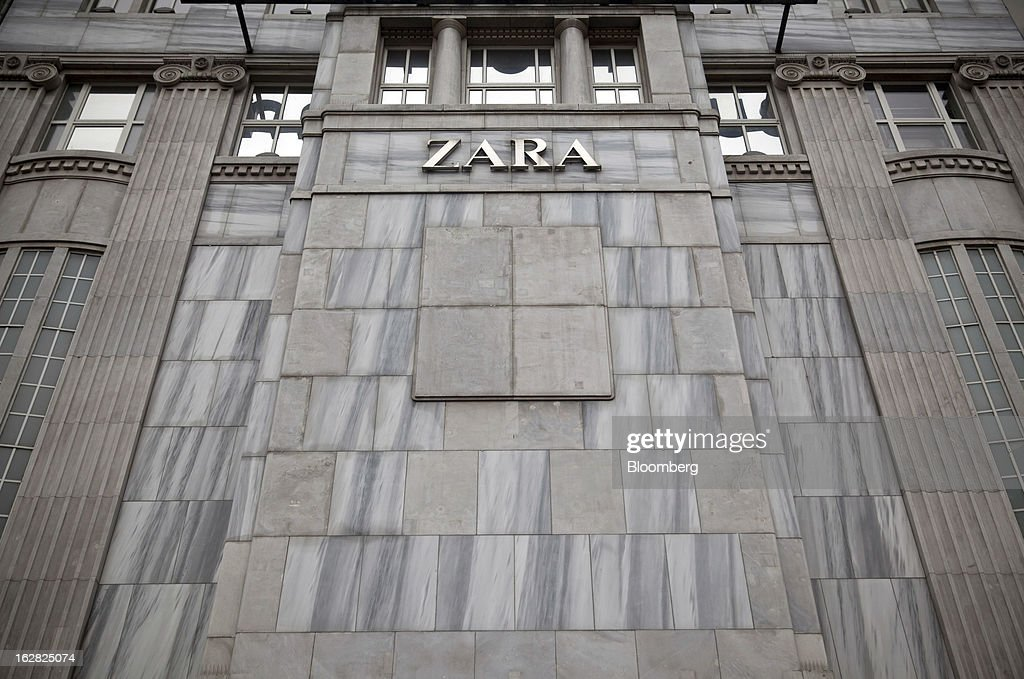 The Zara logo is seen on the outside of a store operated by Inditex SA in Berlin, Germany, on Wednesday, Feb. 27, 2013. German unemployment unexpectedly fell in February amid signs that Europe's biggest economy is returning to growth after a contraction at the end of last year. Photographer: Balint Porneczi/Bloomberg via Getty Images