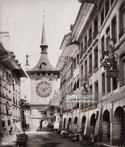 The Zeitglockenturm or Zytglogge in Bern Switzerland circa 1900 On the right are the Hotel des Tisserands and the Hotel du Faucon