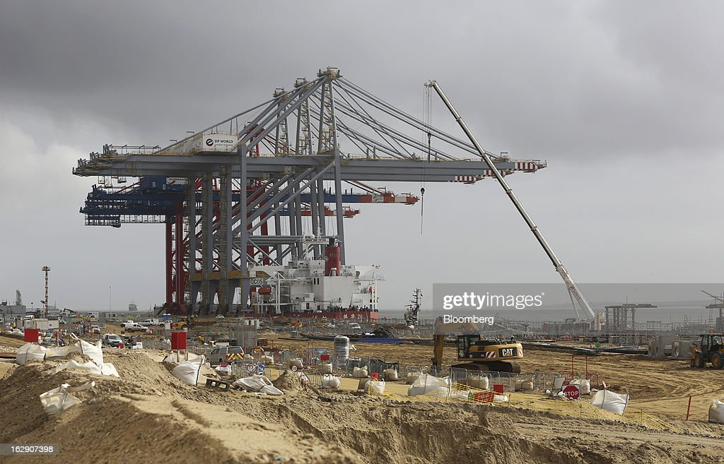The Zhen Hua 26, a semi-submersible heavy load carrier operated by Shanghai Zhenhua Heavy Industry Co. Ltd. (ZPMC), stands at the dockside beyond a construction area as it delivers ship-to-shore container cranes to the new DP World Ltd. London Gateway shipping terminal in Stanford-le-Hope, U.K., on Friday, March 1, 2013. DP World, which operates more than 60 terminals in six continents, said it is on track to open new capacity in Santos in Brazil, Jebel Ali in the United Arab Emirates and London Gateway in the U.K. this year. Photographer: Chris Ratcliffe/Bloomberg via Getty Images
