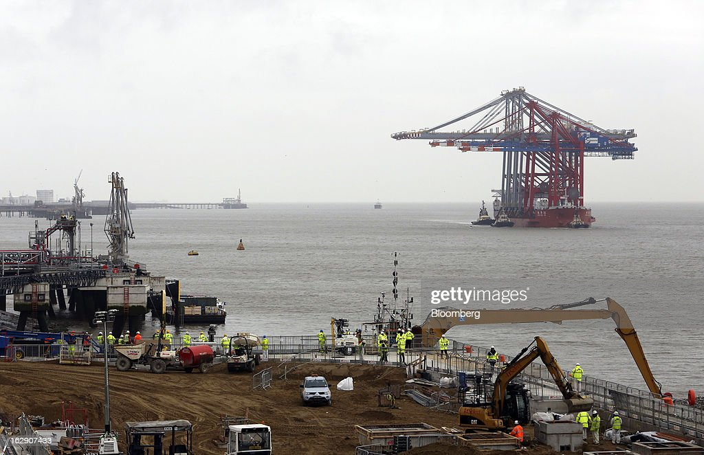 The Zhen Hua 26, a semi-submersible heavy load carrier operated by Shanghai Zhenhua Heavy Industry Co. Ltd. (ZPMC), delivers new ship-to-shore container cranes to the new DP World Ltd. London Gateway shipping terminal in Stanford-le-Hope, U.K., on Friday, March 1, 2013. DP World, which operates more than 60 terminals in six continents, said it is on track to open new capacity in Santos in Brazil, Jebel Ali in the United Arab Emirates and London Gateway in the U.K. this year. Photographer: Chris Ratcliffe/Bloomberg via Getty Images