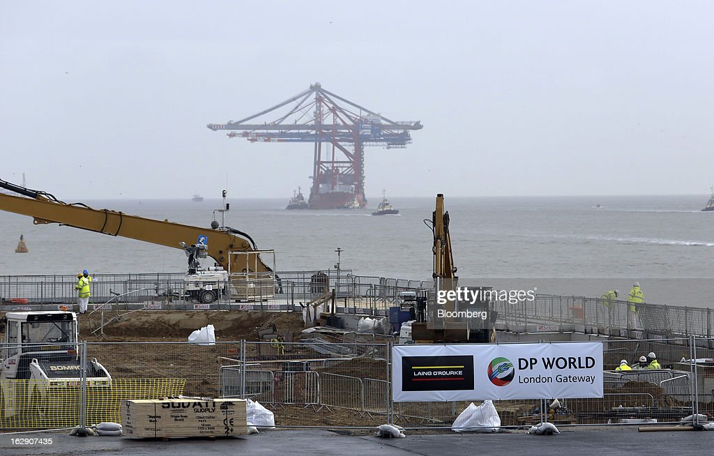 The Zhen Hua 26, a semi-submersible heavy load carrier operated by Shanghai Zhenhua Heavy Industry Co. Ltd. (ZPMC), delivers ship-to-shore container cranes to the new DP World Ltd. London Gateway shipping terminal in Stanford-le-Hope, U.K., on Friday, March 1, 2013. DP World, which operates more than 60 terminals in six continents, said it is on track to open new capacity in Santos in Brazil, Jebel Ali in the United Arab Emirates and London Gateway in the U.K. this year. Photographer: Chris Ratcliffe/Bloomberg via Getty Images