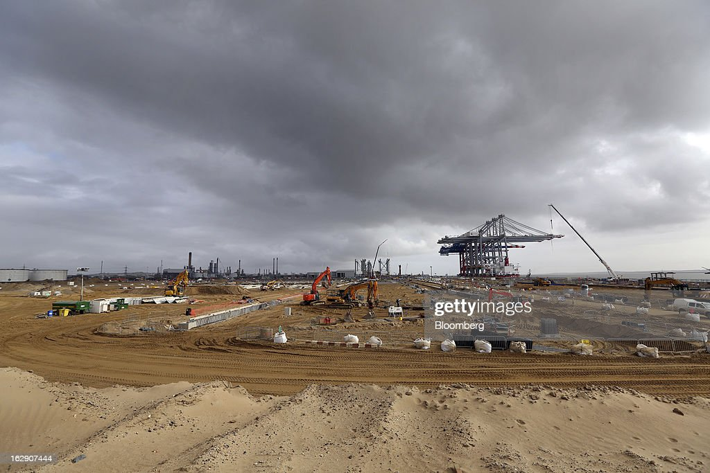 The Zhen Hua 26, a semi-submersible heavy load carrier operated by Shanghai Zhenhua Heavy Industry Co. Ltd. (ZPMC), is seen beyond a construction site as it arrives with its cargo of ship-to-shore container cranes at the new DP World Ltd. London Gateway shipping terminal in Stanford-le-Hope, U.K., on Friday, March 1, 2013. DP World, which operates more than 60 terminals in six continents, said it is on track to open new capacity in Santos in Brazil, Jebel Ali in the United Arab Emirates and London Gateway in the U.K. this year. Photographer: Chris Ratcliffe/Bloomberg via Getty Images