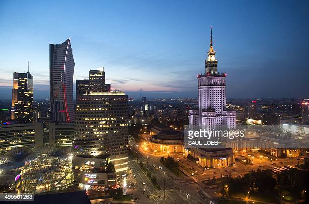 The Zlota 44 tower and the Palace of Culture and Science Poland's tallest building are seen at sunset in central Warsaw Poland June 3 2014 Zlota 44...