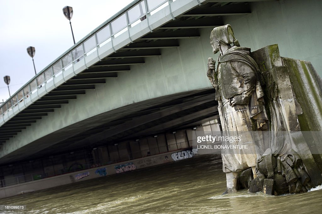 The 'Zouave' soldier statue, built in 1856 by artist George Diebolt on the Alma bridge, is partially submerged on February 9, 2013, as the river Seine's level rose in Paris. Roads along the river are closed to motorists since February 6 after the level of the water was reported at 3,79 meters high instead of the usual 2 meters. AFP PHOTO LIONEL BONAVENTURE