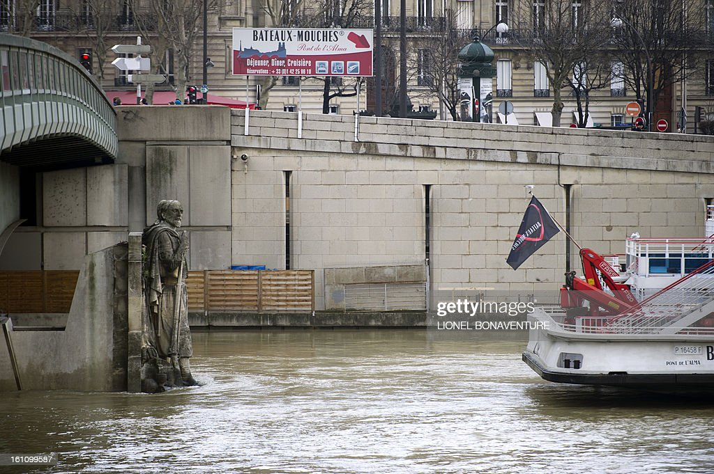 The 'Zouave' soldier statue (L), built in 1856 by artist George Diebolt on the Alma bridge, is partially submerged on February 9, 2013, as the river Seine's level rose in Paris. Roads along the river are closed to motorists since February 6 after the level of the water was reported at 3,79 meters high instead of the usual 2 meters.