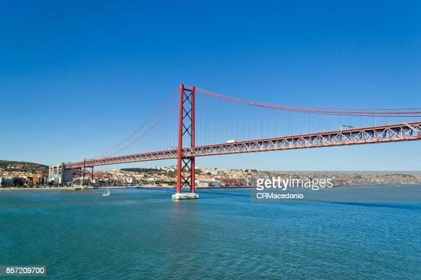 The25 de Abril Bridge(Ponte 25 de Abril) under Blue sky.