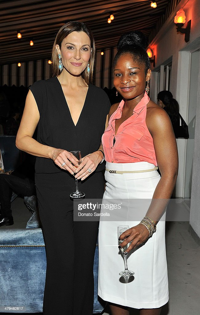 Thea Andrews and Myescha Joell attend Eva Mendes Exclusively at New York & Company Spring launch dinner at Chateau Marmont on March 18, 2014 in Los Angeles, California.