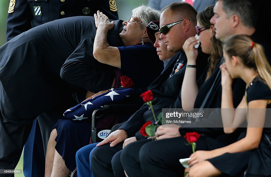 Thea Kurz, the mother of Sgt. First Class Matthew Leggett, hugs friends while attending the burial service for her son at Arlington National Cemetery September 3, 2014 in Arlington, Virginia. Leggett, a paratrooper stationed at Ft. Bragg who received the Bronze Star Medal and Purple Heart, was killed in action on August 20, 2014 while serving his third tour of Afghanistan.