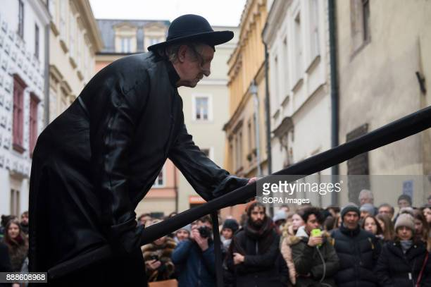 A theater artist perform the 'Living Monuments' character from Kantor's art during the anniversary of Tadeusz Kantor's death in Krakow