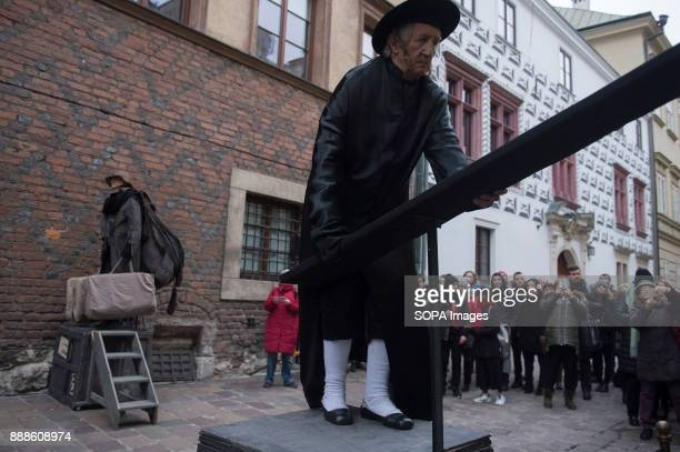 Theater artists perform the 'Living Monuments' characters from Kantor's art during the anniversary of Tadeusz Kantor's death in Krakow