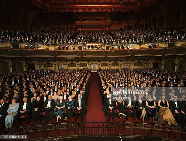 Theater audience in formal attire