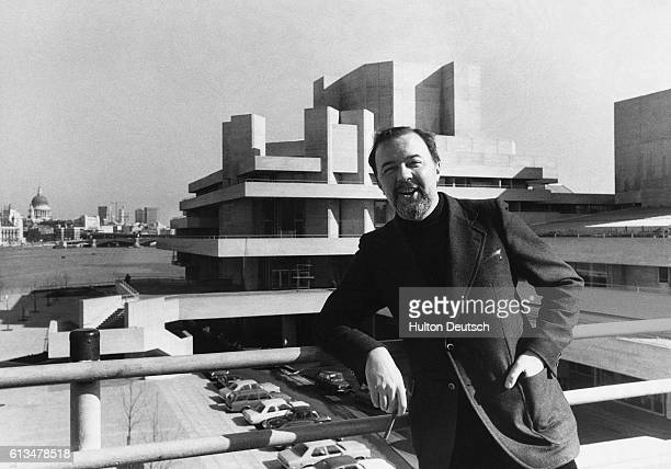 Theater director Peter Hall posing in front of the newly completed National Theatre on the South Bank 1976