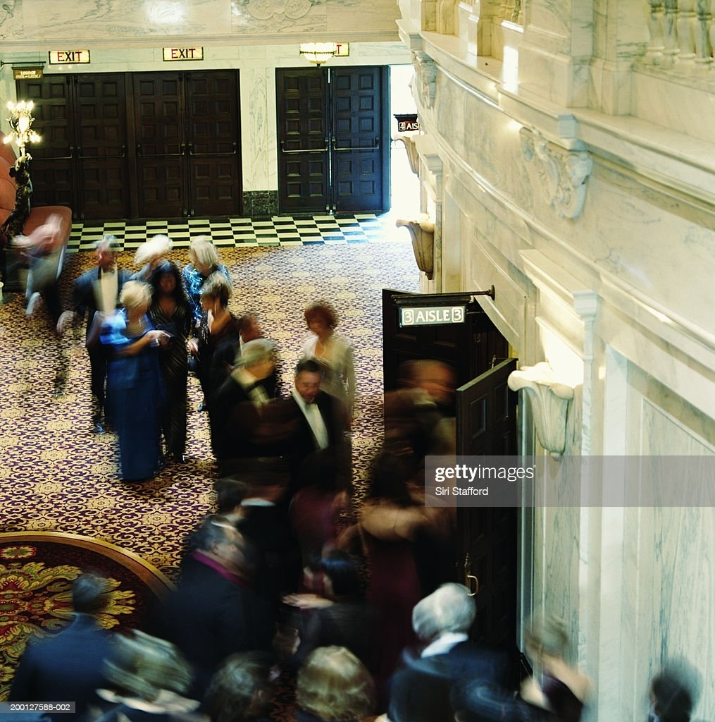 Theater goers in formal attire, entering auditorium, overhead view : Stock Photo