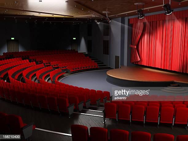 Salle de cinéma avec des sièges vides