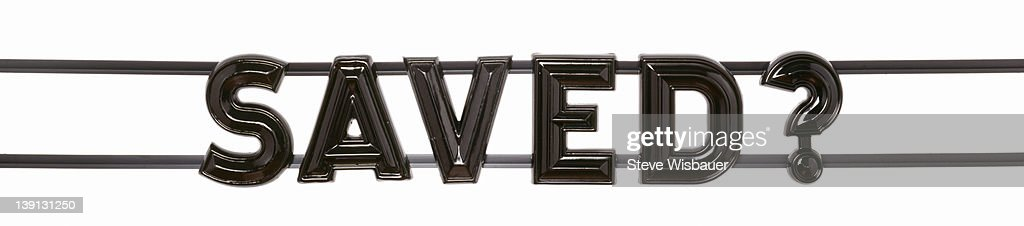 A theater marquee style sign saying saved? : Stock Photo