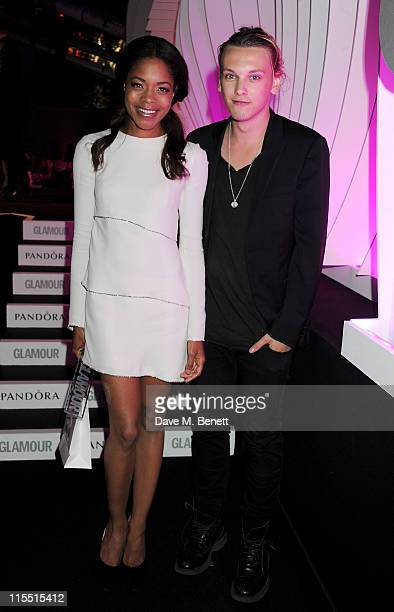 Theatre Actress of the Year winner Naomie Harris and presenter Jamie Campbell Bower pose at the Glamour Women of the Year Awards at Berkeley Square...