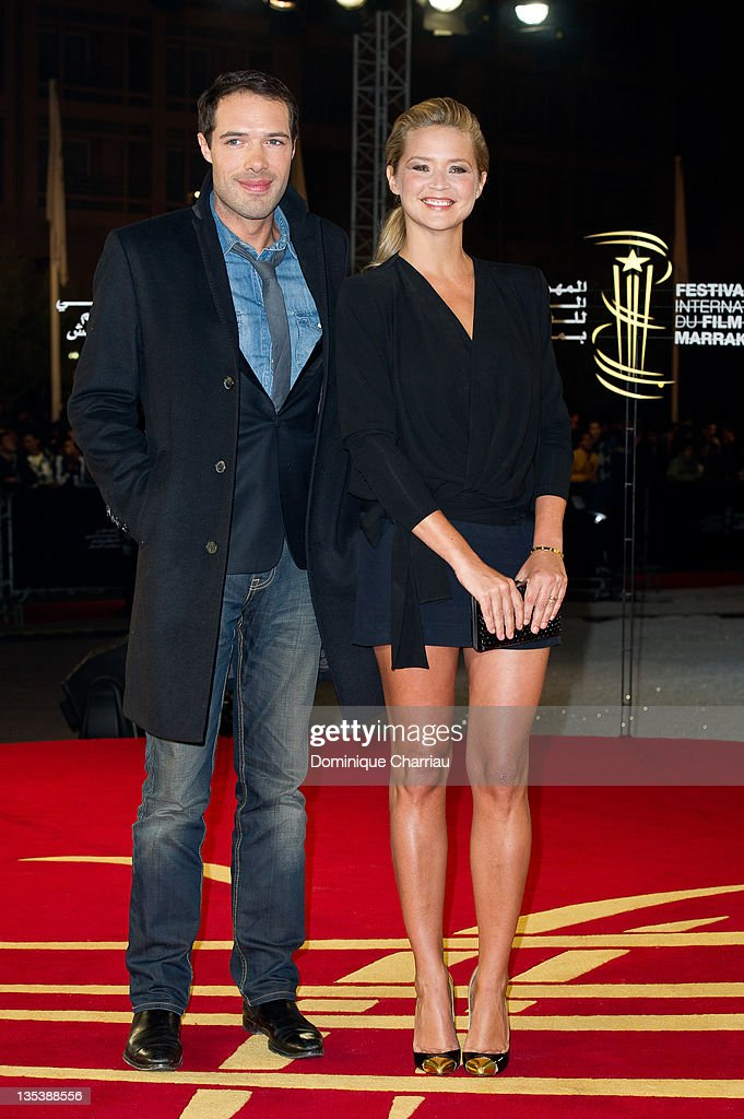 Theatre director and actor Nicolas Bedos poses with TV presenter/actress <a gi-track='captionPersonalityLinkClicked' href=/galleries/search?phrase=Virginie+Efira&family=editorial&specificpeople=228714 ng-click='$event.stopPropagation()'>Virginie Efira</a> as they arrive at the'Miss Bala' Red Carpet Photocall during Marrakech International Film Festival 2011 on December 9, 2011 in Marrakech, Morocco.