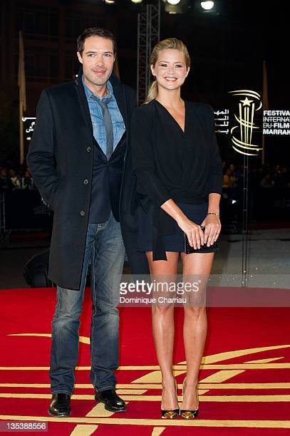 Theatre director and actor Nicolas Bedos poses with TV presenter/actress Virginie Efira as they arrive at the'Miss Bala' Red Carpet Photocall during...